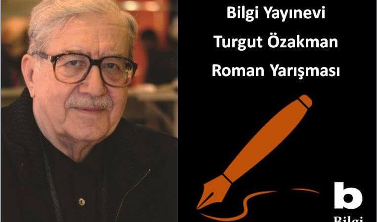 Bilgi Yayınevi Turgut Özakman Roman Yarışması duyuru görselidir. Görselde yazarın fotoğrafı görülmekte ve dolma kalem ikonu yer almaktadır.