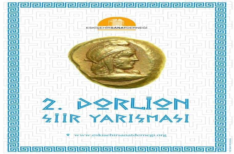 Görselde beyaz mozaik zemin üzerinde altın sarısı bir madalyon bulunmaktadır. Eskişehir Sanat Derneği'nin logosu ve iletişim bilgileri yer almaktadır.