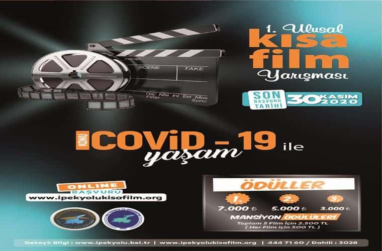 Görselde siyah zemin üzerinde Covid 19 ile Yaşam Kısa Film Yarışması yazmaktadır.